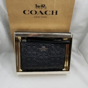 Coach wristlet black glitter signature